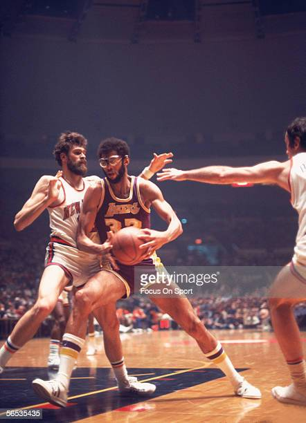 Kareem Abdul Jabbar of the Los Angeles Lakers dribbles near the net against the New Jersey Nets circa the 1970's during a game
