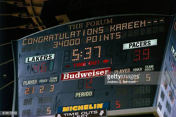 Kareem Abdul Jabbar of the Los Angeles Lakers gets acknowledged on the scoreboard for scoring 34,000 points in his NBA career during an NBA game...