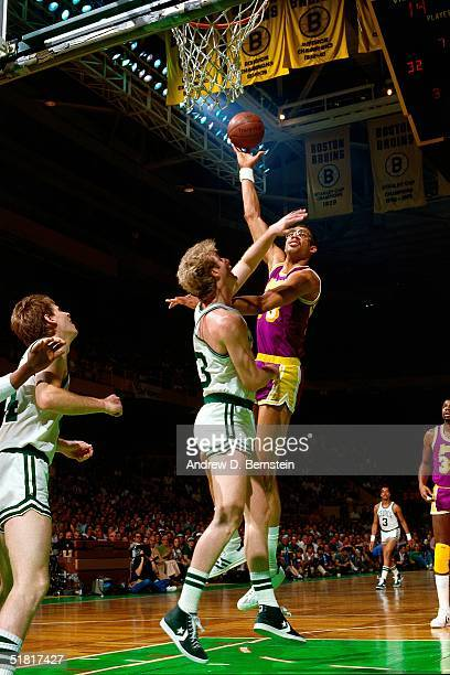Kareem Abdul Jabbar of the Los Angeles Lakers goes up for a sky hook against the Larry Bird of the Boston Celtics during an NBA game circa 1984 at...