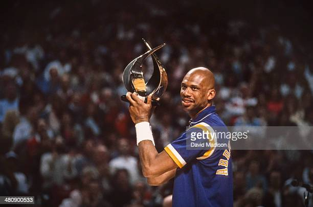 Kareem Abdul Jabbar of the Los Angeles Lakers holds a trophy before an NBA game against the Sacramento Kings played on March 23 1989 at Arco Arena in...
