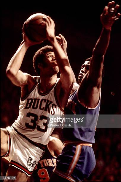 Kareem Abdul Jabbar of the Milwaukee Bucks drives to the basket against Willis Reed of the New York Knicks in Milwaukee Wisconsin NOTE TO USER User...