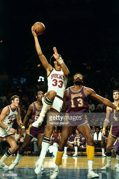 Kareem Abdul Jabbar of the Milwaukee Bucks shoots a hook shot against Wilt Chamberlain of the Los Angeles Lakers during the 1972 season at the MECCA...
