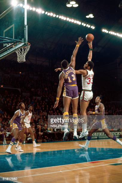 Kareem Abdul Jabbar of the Milwaukee Bucks shoots a hookshot against Wilt Chamberlain of the Los Angeles Lakers during an NBA game in 1970 in...