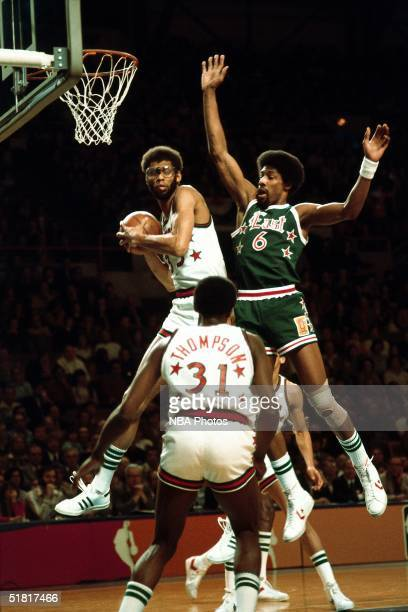 Kareem Abdul Jabbar of the Western Conference AllStars grabs a rebound against the Julius Erving of the Eastern Conference AllStars during an 1977...