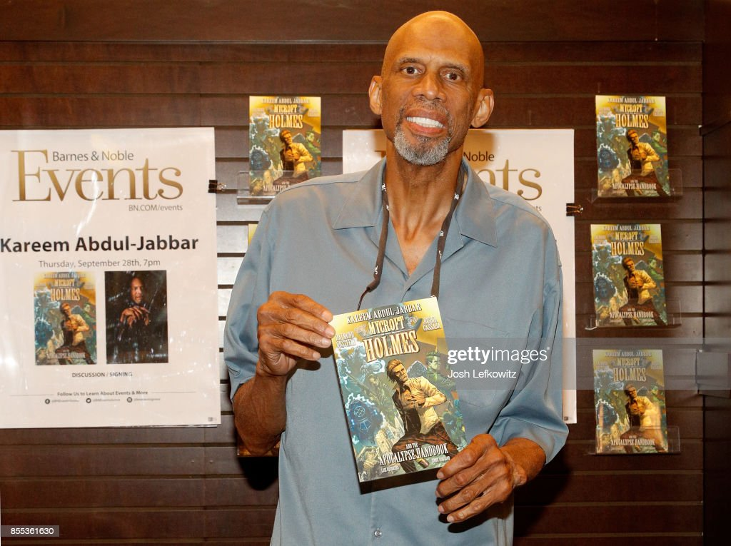 Kareem Abdul Jabbar with his book 'Mycroft Holmes and the Apocalypse Handbook' at Barnes & Noble at The Grove on September 28, 2017 in Los Angeles, California.
