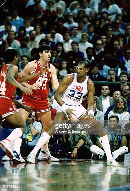 Kareem AbdulJabar of the Western Conference AllStars posts up against Bill Laimbeer of the Eastern Conference AllStars during the 1987 NBA AllStar...