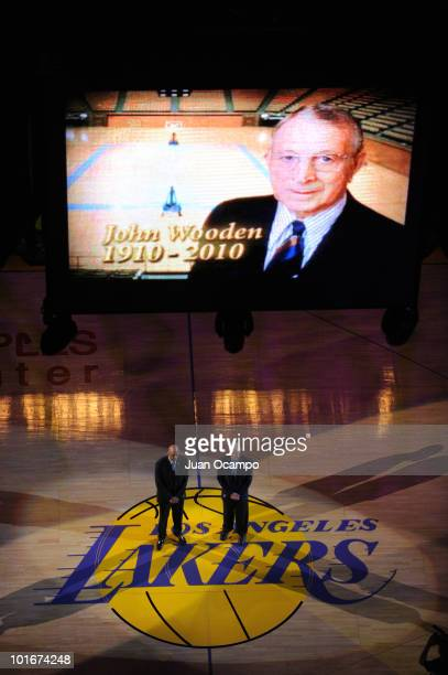 Kareem AbdulJabbar and Bill Walton stand for a moment of silence in memory of the late John Wooden before the Los Angeles Lakers take on the Boston...