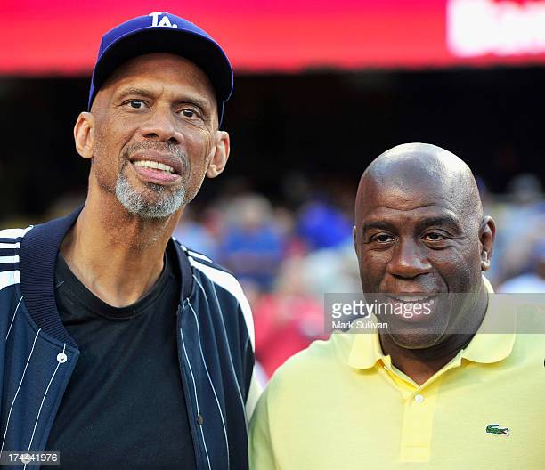 Kareem AbdulJabbar and Earvin 'Magic' Johnson attend the MLB game between the Cincinnatti Reds and Los Angeles Dodgers at Dodger Stadium on July 25...