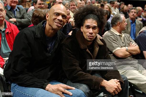 Kareem AbdulJabbar and his son attend the Los Angeles Lakers against the New York Knicks game during the first half of action at Staples Center...