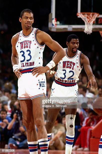 Kareem AbdulJabbar and Magic Johnson of the Western Conference AllStars talk during the 1982 NBA AllStar Game played on January 31 at the Brendan...
