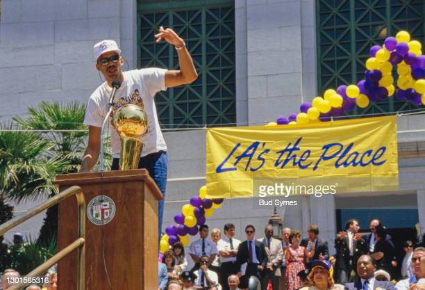 Kareem Abdul-Jabbar, Center for the Los Angeles Lakers celebrates with the Larry O'Brien Championship Trophy during the parade to honour the Los...