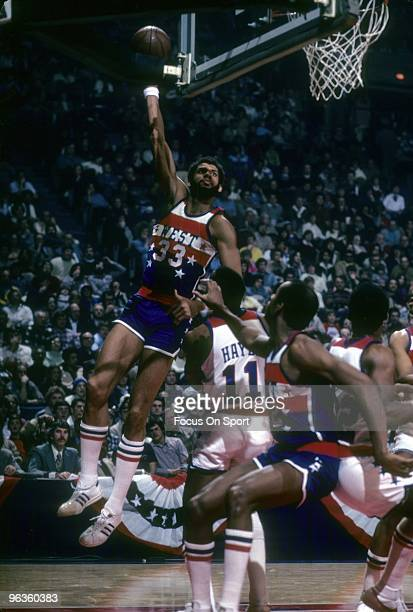 Kareem AbdulJabbar of the Los Angeles Lakers and the West Allstars shoots over Elvin Hayes of the Capital Bullets and the east Allstars during the...