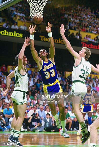 Kareem AbdulJabbar of the Los Angeles Lakers battles for the ball with Greg Kite and Larry Bird of the Boston Celtics during the 1987 NBA Basketball...