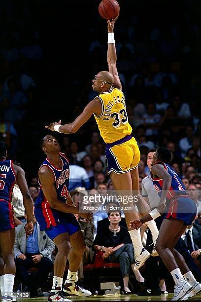 Kareem AbdulJabbar of the Los Angeles Lakers goes up for a sky hook against the Detroit Pistons during an NBA game circa 1988 at the Forum in...
