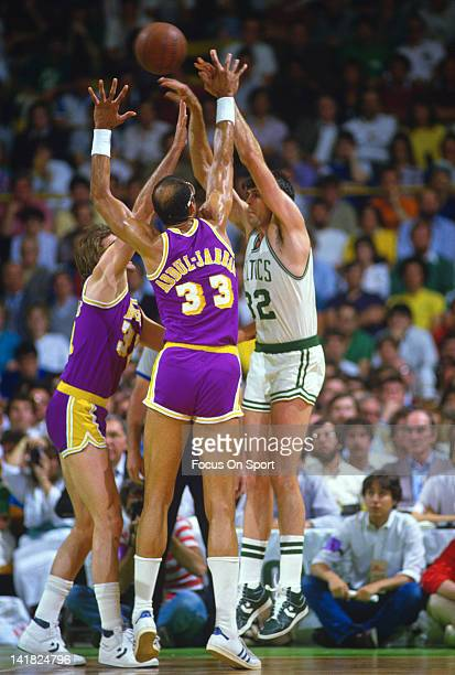 Kareem AbdulJabbar of the Los Angeles Lakers guards Kevin McHale of the Boston Celtics during the 1985 NBA Basketball Finals at the Boston Garden in...