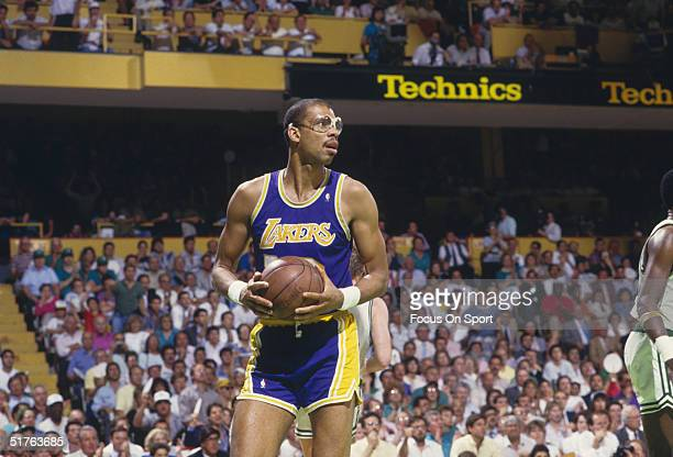 Kareem AbdulJabbar of the Los Angeles Lakers looks for a pass against the Boston Celtics during a 1987 NBA game at the Boston Garden in Boston...