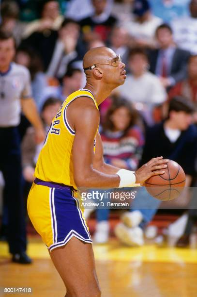 Kareem AbdulJabbar of the Los Angeles Lakers shoots a free throw during a game played circa 1989 at the Great Western Forum in Inglewood California...