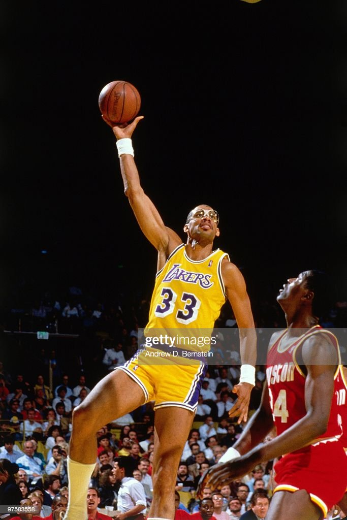 Kareem Abdul-Jabbar #33 of the Los Angeles Lakers shoots a hook shot against Hakeem Olajuwon #34 of the Houston Rockets during a game played in 1988 at the Great Western Forum in Inglewood, California.