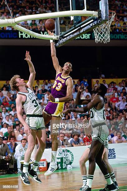 Kareem AbdulJabbar of the Los Angeles Lakers shoots a hook shot against Larry Bird and Robert Parish of the Boston Celtics during the 1985 NBA Finals...