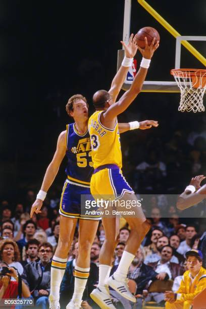 Kareem AbdulJabbar of the Los Angeles Lakers shoots a jump hook against Mark Eaton of the Utah Jazz during a game played circa 1988 at the Great...