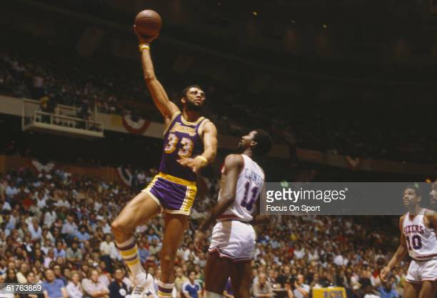 Kareem AbdulJabbar of the Los Angeles Lakers shoots a skyhook over a player of the 76ers during the 1982 NBA finals at the Spectrum in Philadelphia...