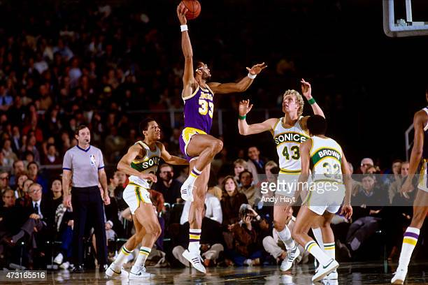 Kareem AbdulJabbar of the Los Angeles Lakers shoots against Jack Sikma of the Seattle SuperSonics circa 1980 at the Kingdome in Seattle WA NOTE TO...