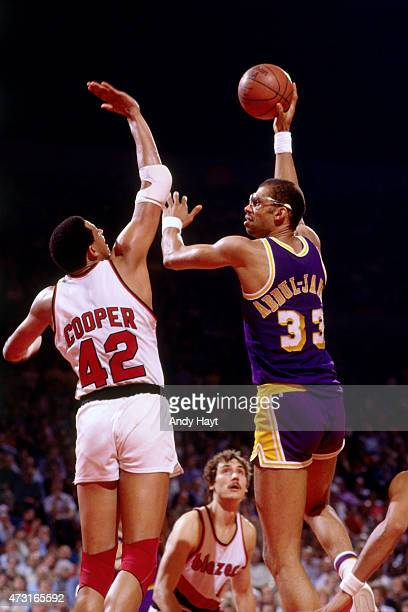 Kareem AbdulJabbar of the Los Angeles Lakers shoots against Wayne Cooper of the Portland Trail Blazers circa 1989 at Memorial Coliseum in Portland...