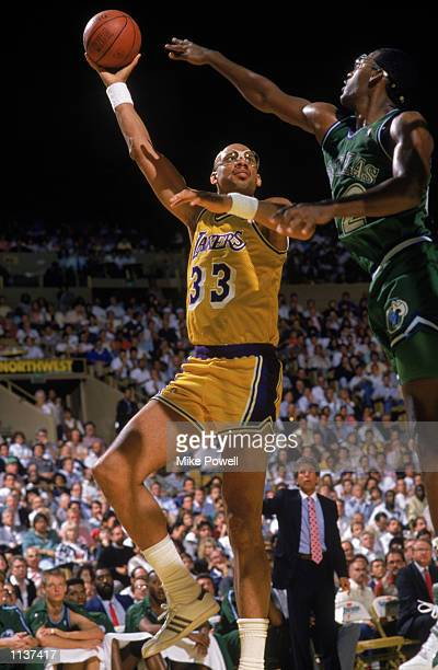 Kareem AbdulJabbar of the Los Angeles Lakers shoots the sky hook during an NBA game against the Dallas Mavericks at the Great Western Forum in Los...