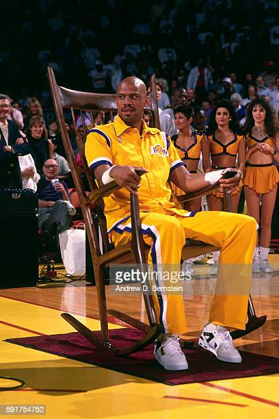 Kareem AbdulJabbar of the Los Angeles Lakers sits in a big rocking chair before his last game against the Seattle SuperSonics on April 23 1989 at The...