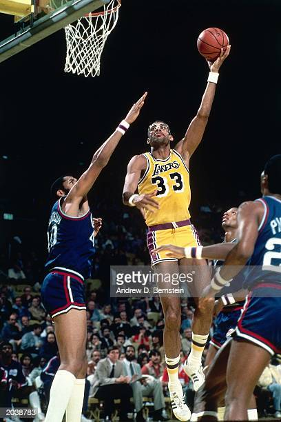 Kareem AbdulJabbar of the Los Angeles Lakers takes a sky hook shot during the 1985 season NBA game against the Los Angeles Clippers at the Great...