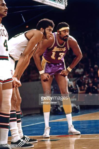 Kareem Abdul-Jabbar of the Milwaukee Bucks and Wilt Chamberlain of the Los Angeles Lakers look on during the game on December 21, 1970 at the...