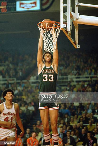 Kareem AbdulJabbar of the Milwaukee Bucks goes up for a jam in front of Wes Unseld of the Baltimore Bullets during an NBA basketball game circa 1970...