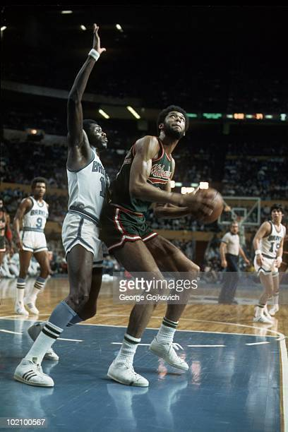 Kareem AbdulJabbar of the Milwaukee Bucks looks to shoot against Bob McAdoo of the Buffalo Braves during a National Basketball Association game at...