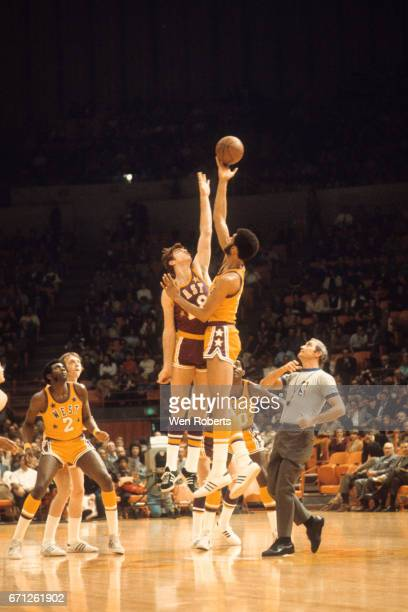 Kareem AbdulJabbar of the West jumps for the opening tip against Dave Cowens of the East during the 1972 NBA AllStar Game on January 18 1972 at The...