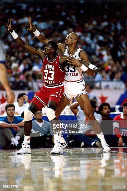 Kareem AbdulJabbar of the Western Conference AllStars defends against Patrick Ewing of the Eastern Conference AllStars during the 1989 NBA AllStar...