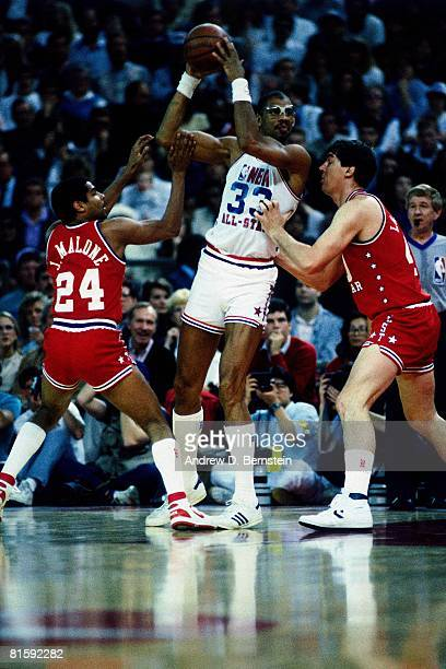 Kareem AbdulJabbar of the Western Conference AllStars posts up against Bill Laimbeer and Jeff Malone of the Eastern Conference AllStars during the...