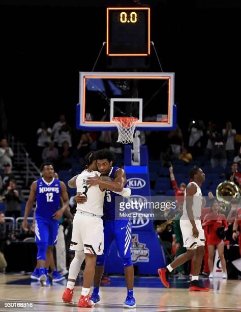 Kareem Brewton Jr #5 of the Memphis Tigers hugs Justin Jenifer of the Cincinnati Bearcats after a semifinal game of the 2018 AAC Basketball...