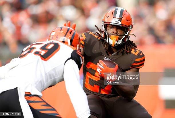Kareem Hunt of the Cleveland Browns attempts to run the ball past Nick Vigil of the Cincinnati Bengals during the first quarter at FirstEnergy...