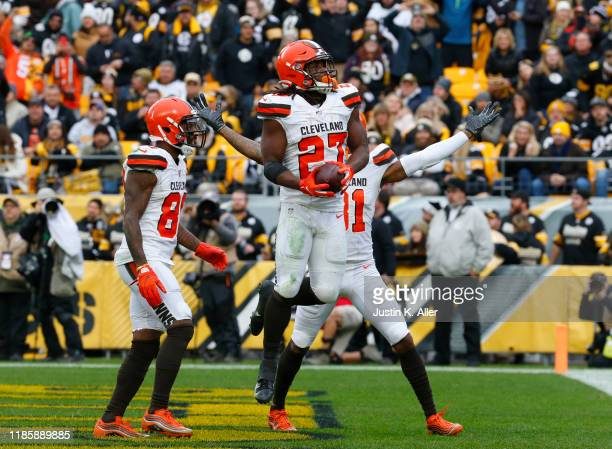 Kareem Hunt of the Cleveland Browns celebrates after scoring on a 15-yard touchdown pass in the first half against the Pittsburgh Steelers on...