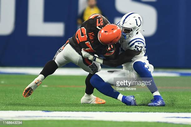 Kareem Hunt of the Cleveland Browns is brought down by Darius Leonard of the Indianapolis Colts during the first half at Lucas Oil Stadium on August...