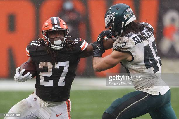 Kareem Hunt of the Cleveland Browns is pursued by Alex Singleton of the Philadelphia Eagles during the second half at FirstEnergy Stadium on November...