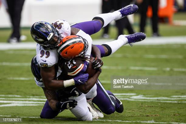 Kareem Hunt of the Cleveland Browns is tackled by Matthew Judon of the Baltimore Ravens during the first half at M&T Bank Stadium on September 13,...