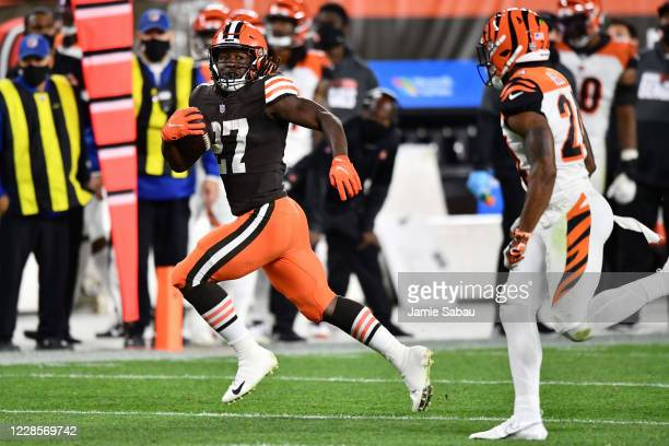 Kareem Hunt of the Cleveland Browns picks up a first down in the fourth quarter against the Cincinnati Bengals at FirstEnergy Stadium on September...