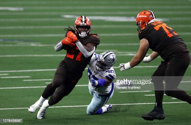 Kareem Hunt of the Cleveland Browns runs the ball against the Dallas Cowboys in the second quarter at AT&T Stadium on October 04, 2020 in Arlington,...