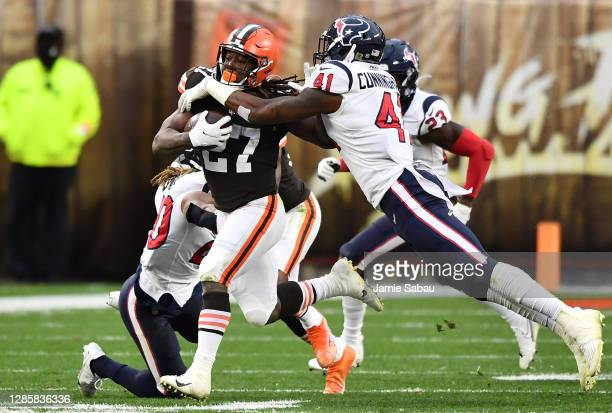 Kareem Hunt of the Cleveland Browns runs the ball against Zach Cunningham of the Houston Texans during the second half at FirstEnergy Stadium on...