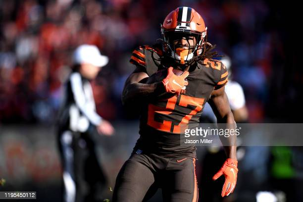 Kareem Hunt of the Cleveland Browns runs with the ball against the Baltimore Ravens in the game at FirstEnergy Stadium on December 22, 2019 in...