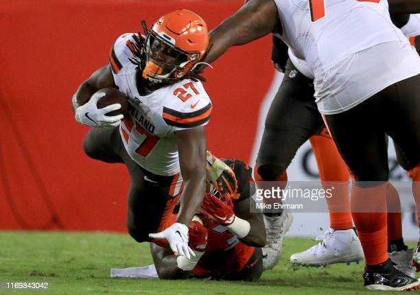 Kareem Hunt of the Cleveland Browns rushes during a preseason game against the Tampa Bay Buccaneers at Raymond James Stadium on August 23, 2019 in...