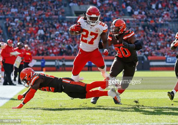 Kareem Hunt of the Kansas City Chiefs avoids a tackle by Jabrill Peppers of the Cleveland Browns during the second quarter at FirstEnergy Stadium on...