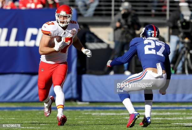 Kareem Hunt of the Kansas City Chiefs carries the ball against Darian Thompson of the New York Giants in the first quarter on November19 2017 at...