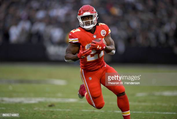 Kareem Hunt of the Kansas City Chiefs carries the ball against the Oakland Raiders during their NFL football game at OaklandAlameda County Coliseum...
